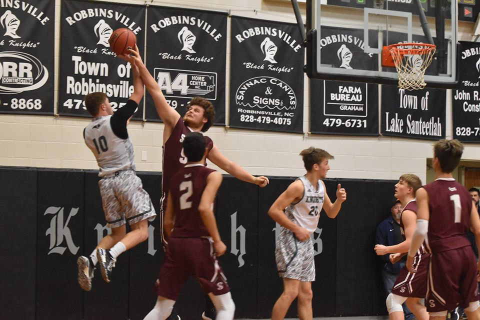 Maroon Devils Use Strong 1st Half to Take 63-49 Win